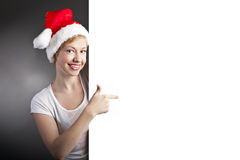 Sexy woman happy smiling and holding empty banner Royalty Free Stock Image