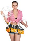 Sexy woman in hard hat and tool belt holding coil Royalty Free Stock Image