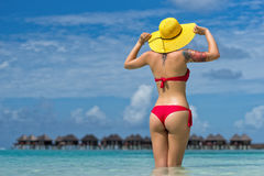 Woman in hat on the tropical beach.  royalty free stock photo
