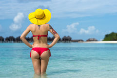 Woman in hat on the tropical beach.  royalty free stock photos