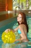 Sexy woman having fun in swimming pool Stock Photos