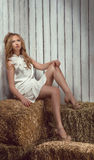 Sexy woman on hayloft Royalty Free Stock Image