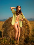 woman by haystack Stock Images