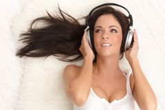 Sexy woman with headphones Royalty Free Stock Photography