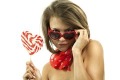 Sexy woman with heart shaped lollipop Stock Photos