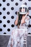 Sexy woman in helmet. Portrait of a sexy woman in lingerie sitting on a chair with the pilot helmet on his head Royalty Free Stock Image