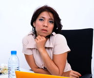 Beautiful woman at her desk Royalty Free Stock Images