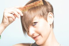 woman with her hair done. Close-up of a girl combing her hair royalty free stock photography