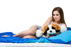 Sexy woman with her plush dog Stock Image