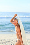 Sexy woman with her surfboard Royalty Free Stock Photography