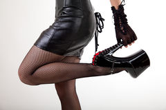 Sexy woman in high-heeled shiny shoes Stock Photography