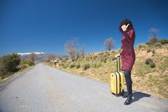 woman hitch-hiking Royalty Free Stock Photo