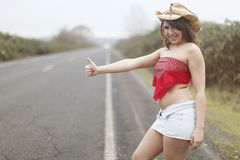 Sexy woman hitchhiking Stock Photography
