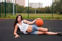 Sexy Woman Holding Basketball In Hand Stock Photography