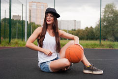 Sexy Woman Holding Basketball In Hand Stock Images