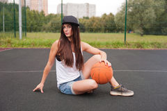 Sexy Woman Holding Basketball In Hand Stock Image