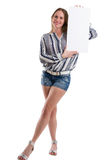Sexy woman holding a blank white board to present something Stock Photo