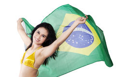 Sexy woman holding Brazil flag in studio Stock Photo