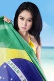 Sexy woman holding brazilian flag Royalty Free Stock Image