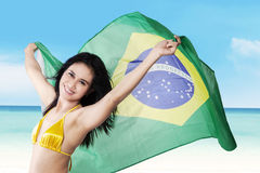 Sexy woman holding brazilian flag on seaside Royalty Free Stock Photos