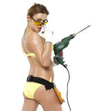Sexy woman holding a construction drill Stock Images