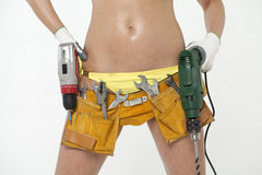 Sexy woman holding a construction drill Royalty Free Stock Image