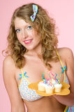Sexy woman holding cupcakes Royalty Free Stock Photos
