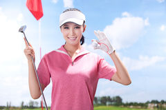 Sexy woman holding golf clubs Royalty Free Stock Photography