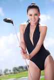 Sexy woman holding golf clubs Royalty Free Stock Photos