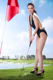 Sexy woman holding golf clubs Stock Photos