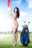 Sexy woman holding golf clubs Royalty Free Stock Image