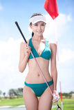 Sexy woman holding golf clubs Royalty Free Stock Images