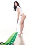 Sexy woman holding golf clubs Royalty Free Stock Photo