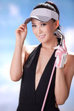 Sexy woman holding golf clubs Stock Photo