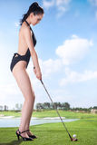 Sexy woman holding golf clubs Stock Photography