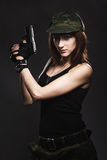 Sexy woman holding gun Stock Image