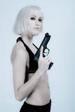 Sexy woman holding gun Stock Photo