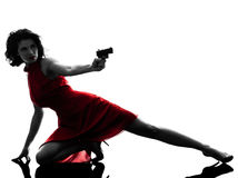 Sexy woman holding gun  silhouette Royalty Free Stock Photography