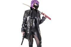 Sexy woman holding katana and handgun. Royalty Free Stock Photo