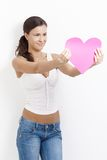 woman holding paper heart smiling Royalty Free Stock Photo