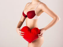 Sexy woman holding red heart Royalty Free Stock Photo