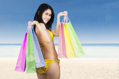 Sexy woman holding shopping bags Royalty Free Stock Photo