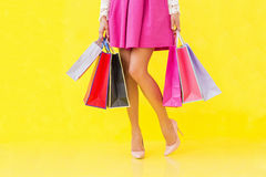 Sexy woman holding shopping bags Stock Image