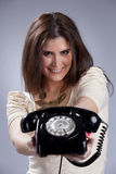 Sexy woman holding a telephone Stock Image