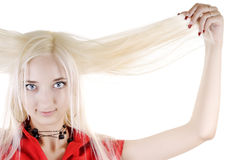 Sexy woman holds her long white hair Stock Image