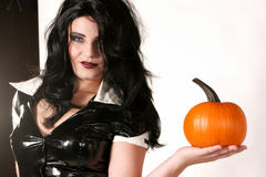 Sexy Woman Holds Pumpkin Stock Images