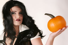 Sexy Woman Holds Pumpkin Royalty Free Stock Images