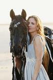 Sexy woman with horse Royalty Free Stock Image