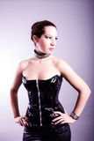Sexy woman with hourglass figure in black leather corset Royalty Free Stock Photo