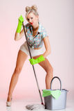 Sexy woman housewife cleaner with mop. Full length sexy girl retro style with mop, woman housewife cleaner in domestic role. Traditional sharing household chores Royalty Free Stock Photography